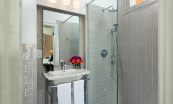 Beautiful tiled shower, sink and radiant heat floor!